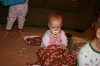 Cecile trying to open a present